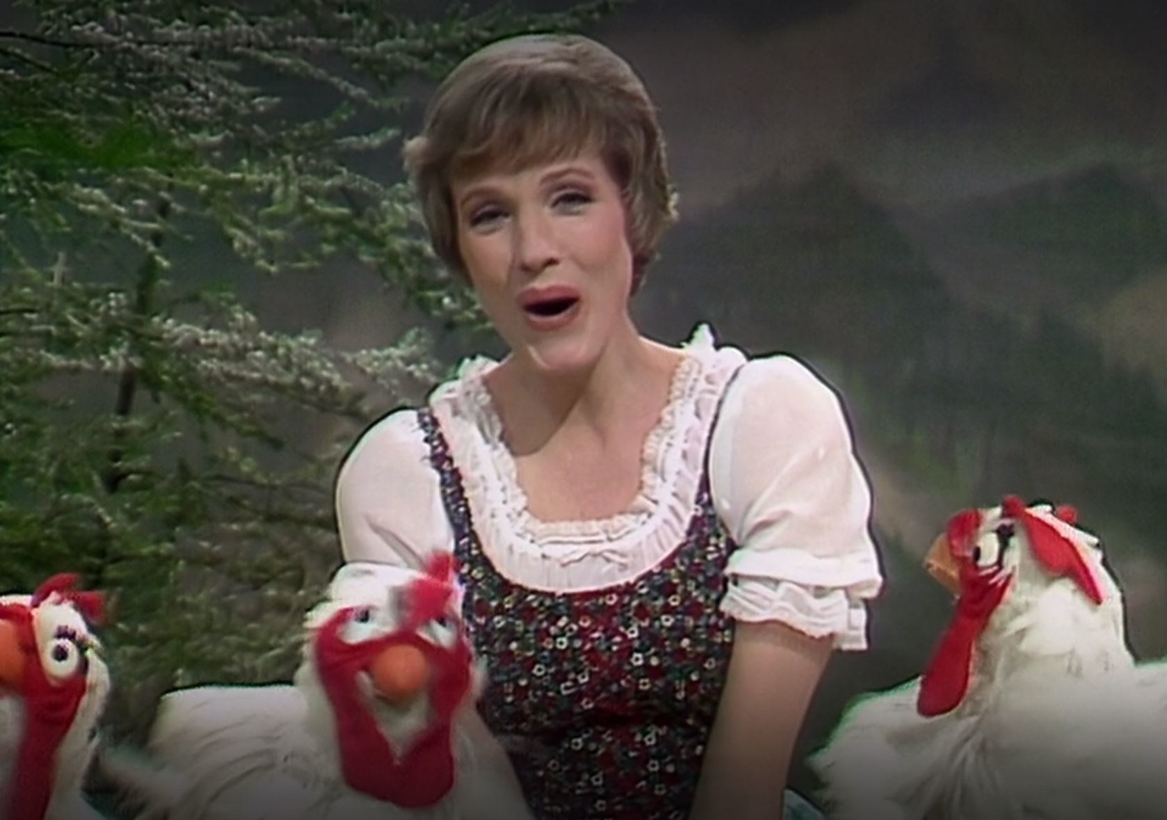 Julie Andrews sings with three chickens