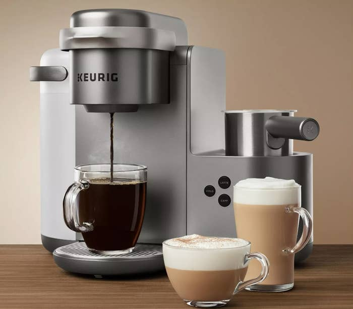 The silver Keurig coffee maker making a hot cup off coffee