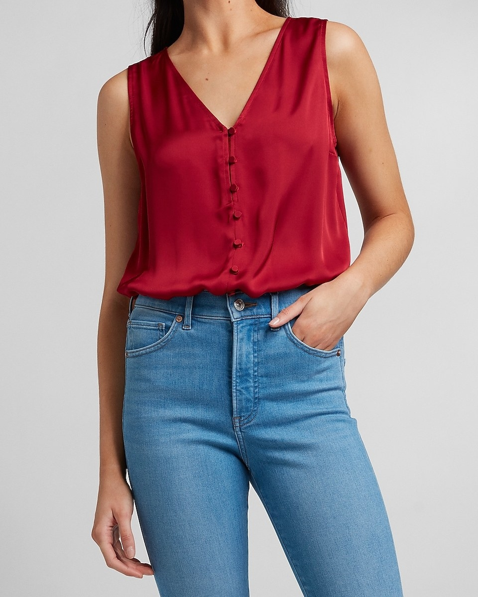 model wearing the bodysuit in pomegranate tucked into jeans