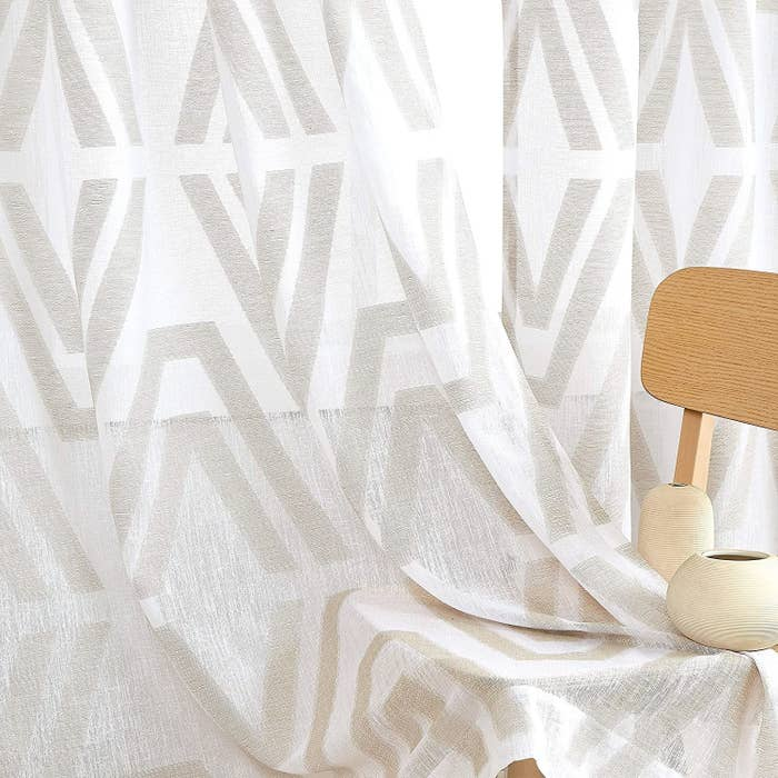 Slightly sheer panel curtains in white with cream triangle pattern