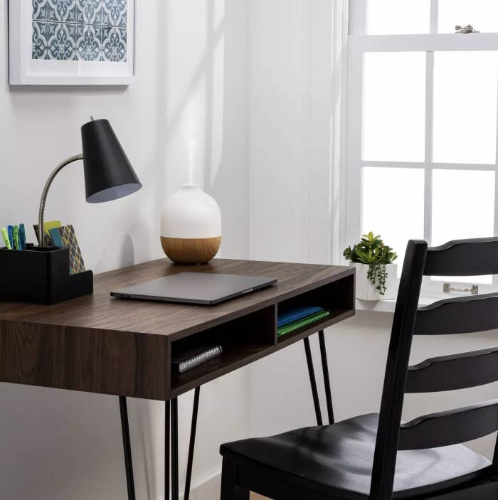 The white and faux wood diffuser on a desk