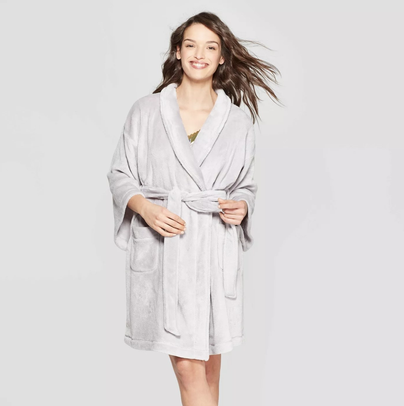 Model is wearing a light grey robe