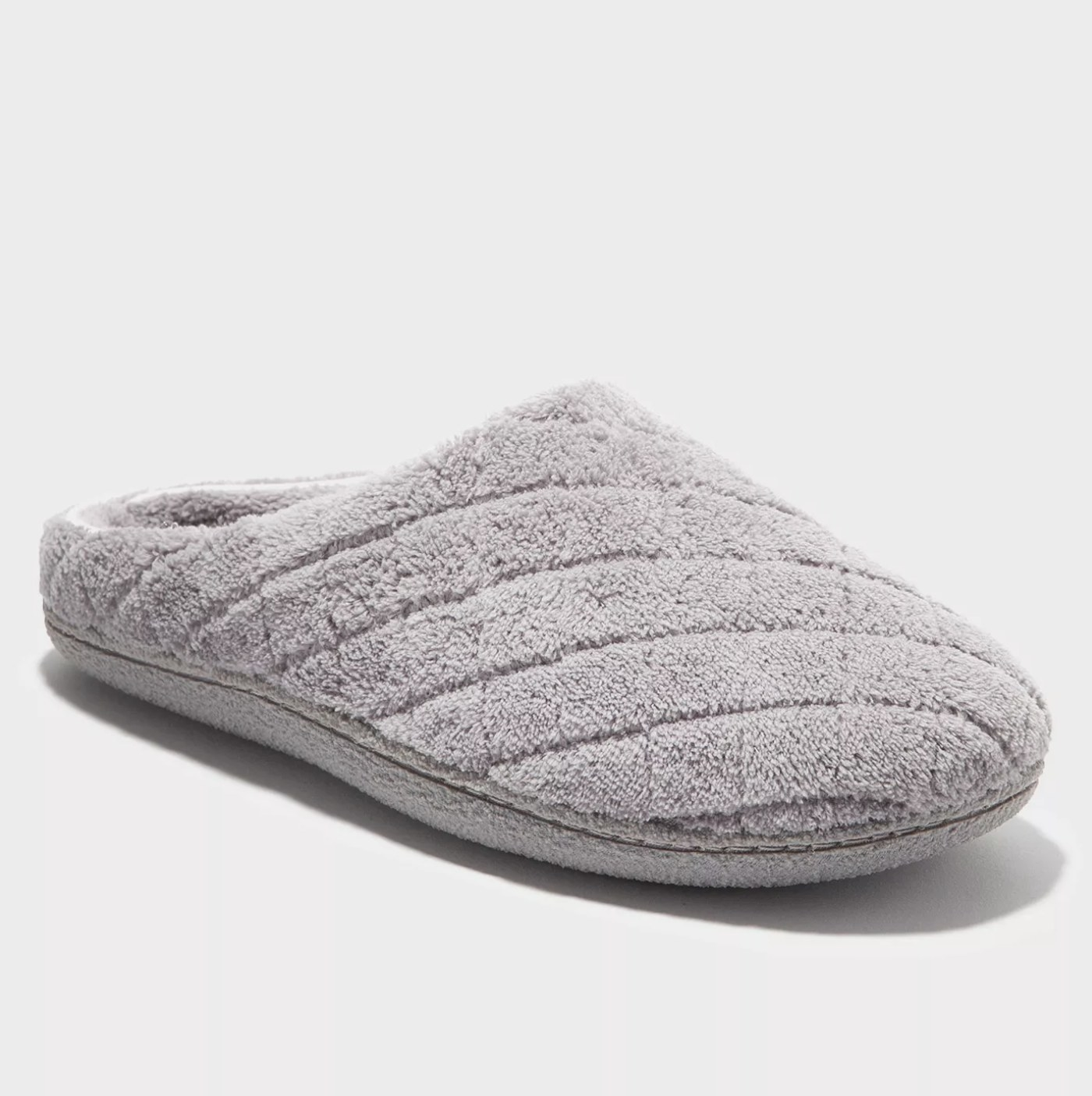 A light grey slipper with a quilted pattern