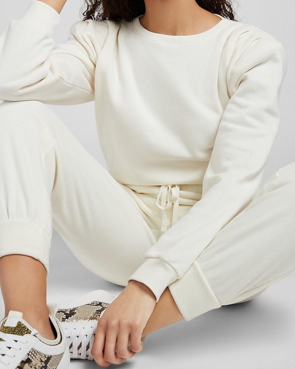 model wearing the sweatshirt in cream