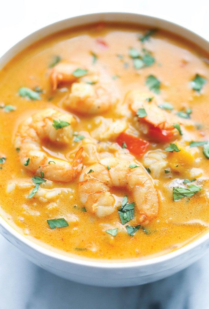 A bowl of creamy Thai shrimp curry soup.