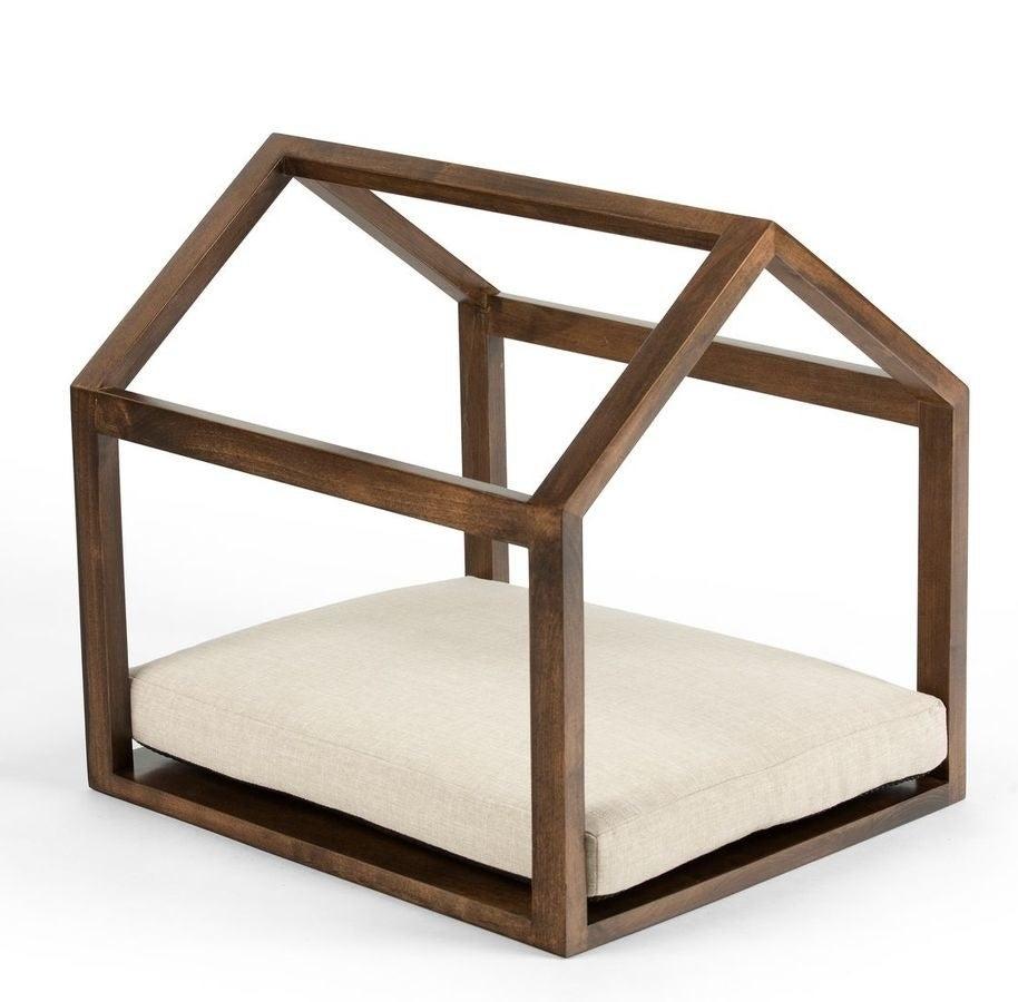the pet cabana with hazel wood and a beige cushion