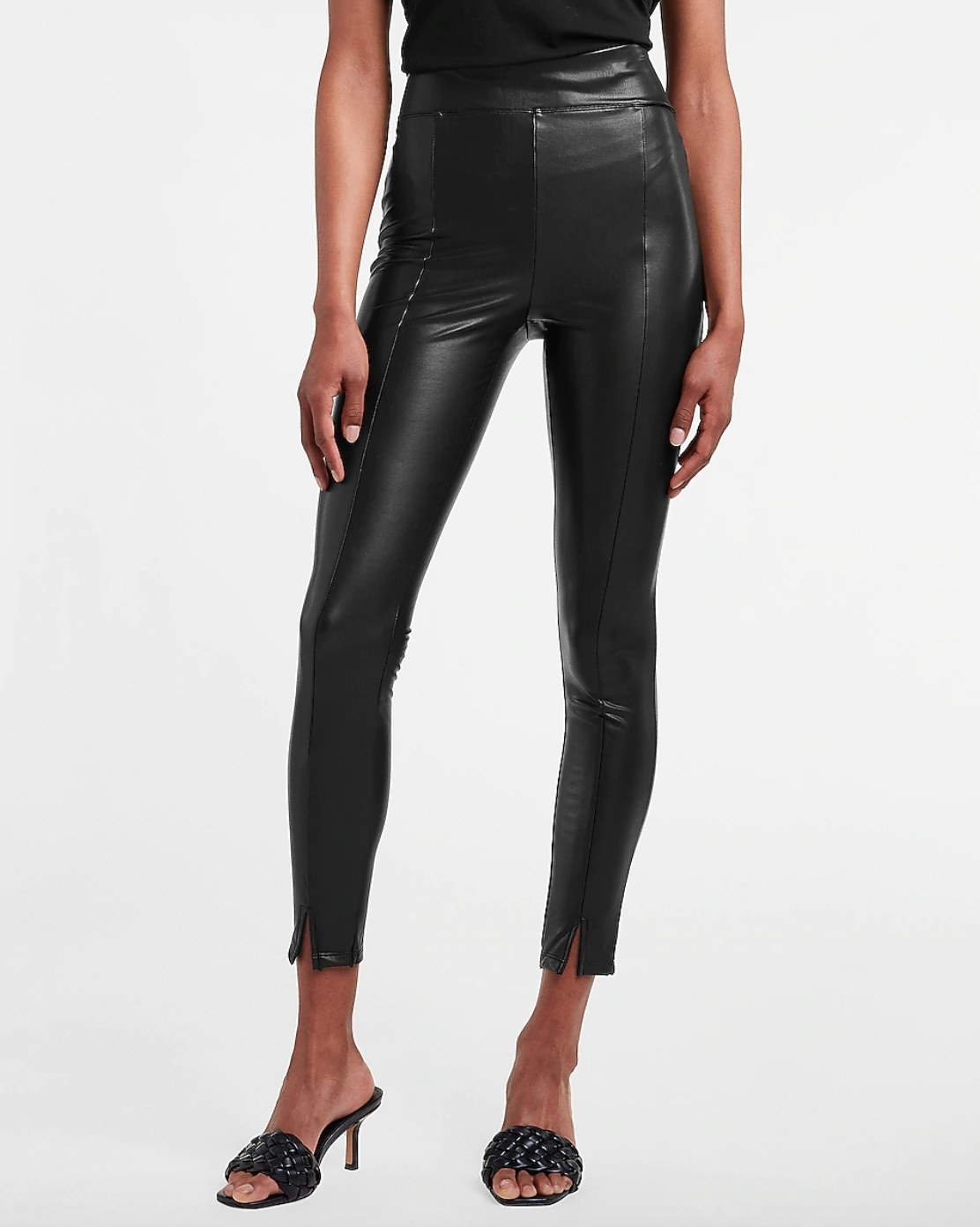 model wearing the pair of super high waisted vegan leather pants in black