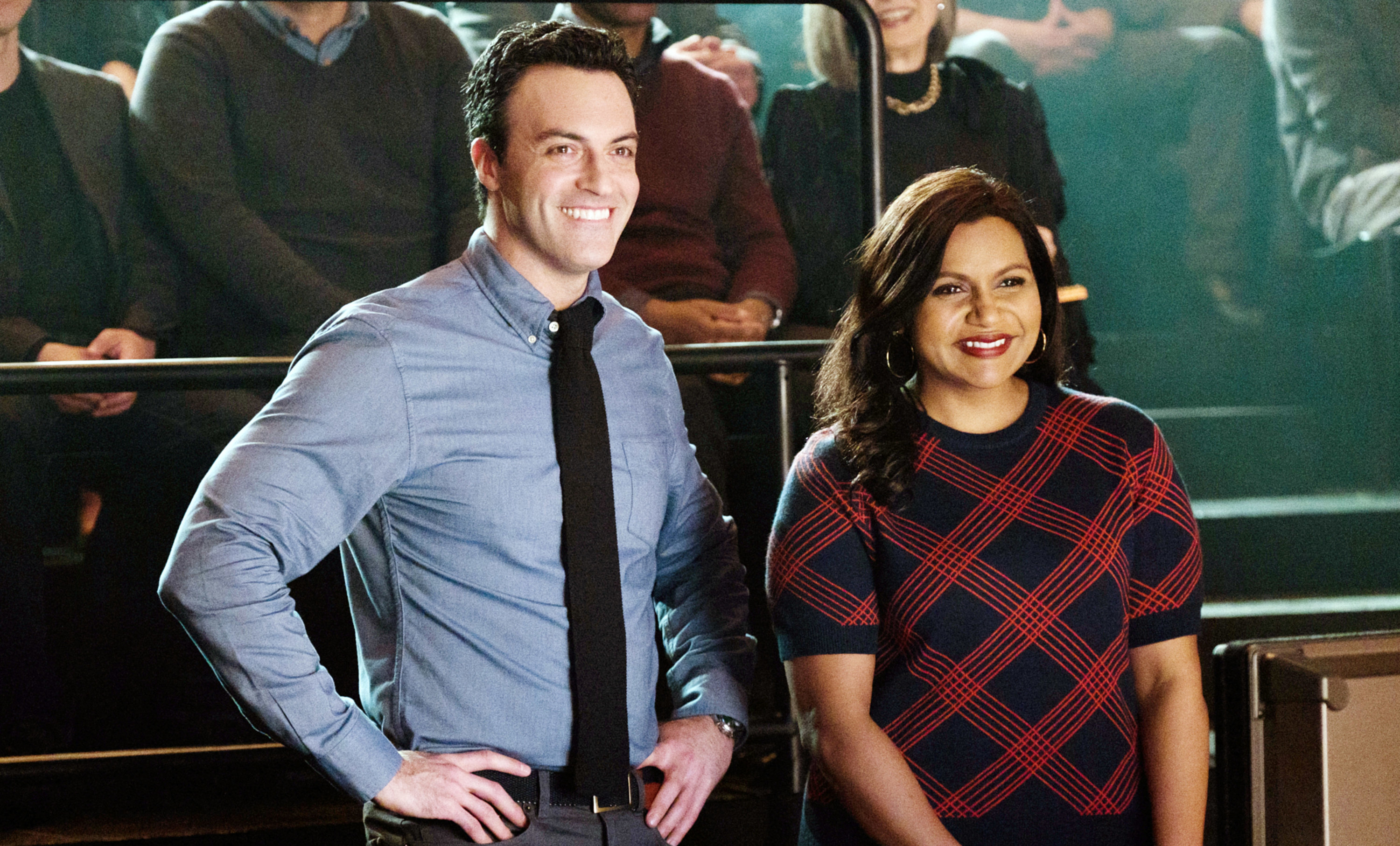 still image of reid scott and mindy kaling in the movie late night, both are looking ahead smiling