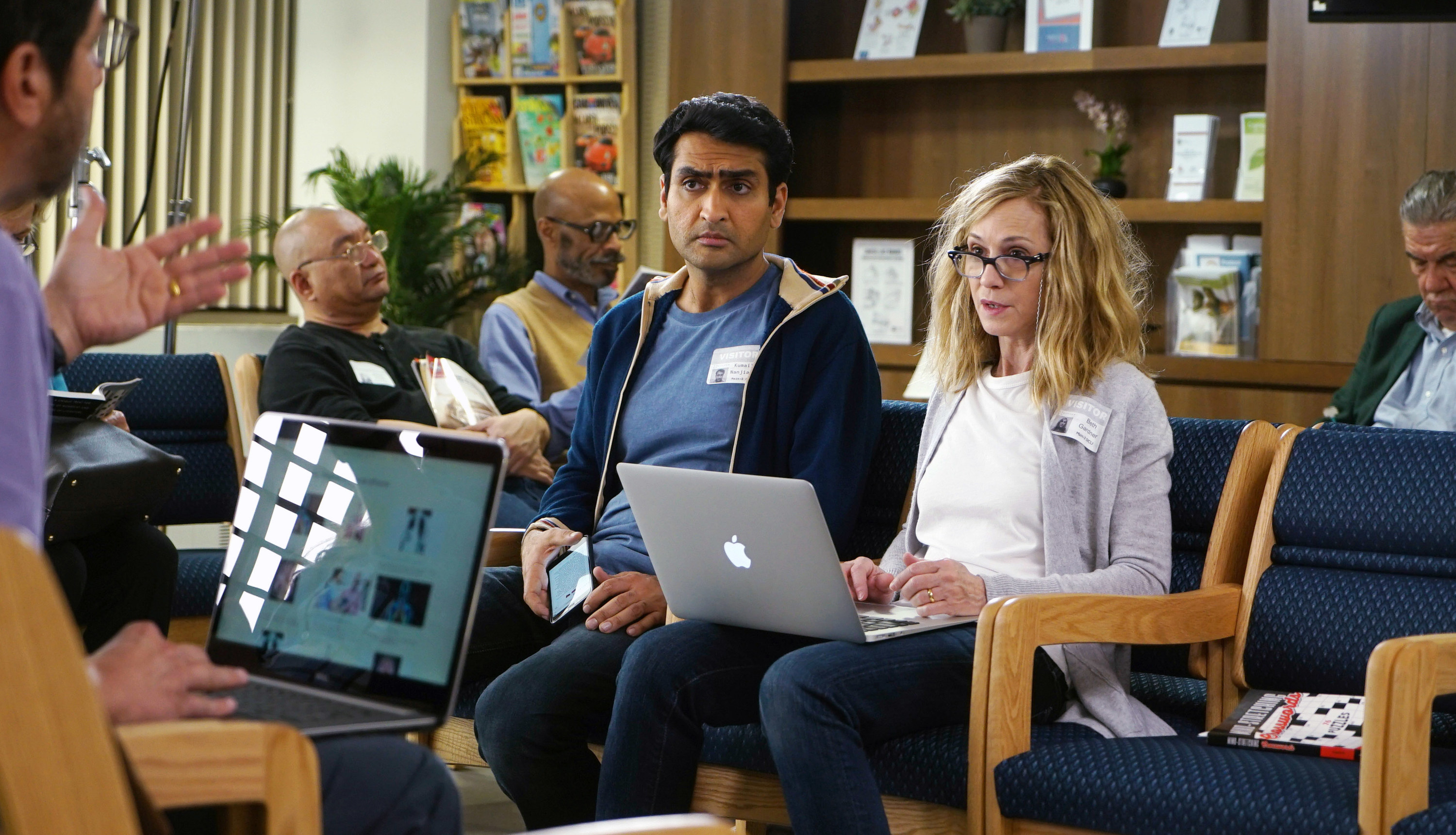 still image from the movie the big sick kumail nanjiani and holly hunter are talking to someone else while on their laptops and phone