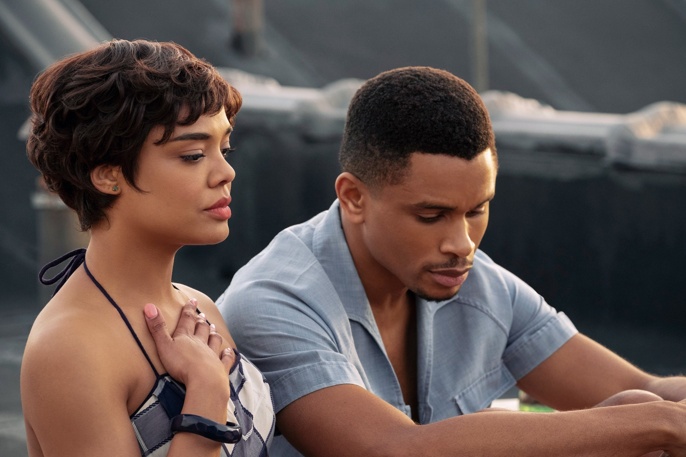 still image from the movie sylvie's love with tessa thompson and nnamdi asomugha. they are both sitting down talking while tessa has her hand on her chest