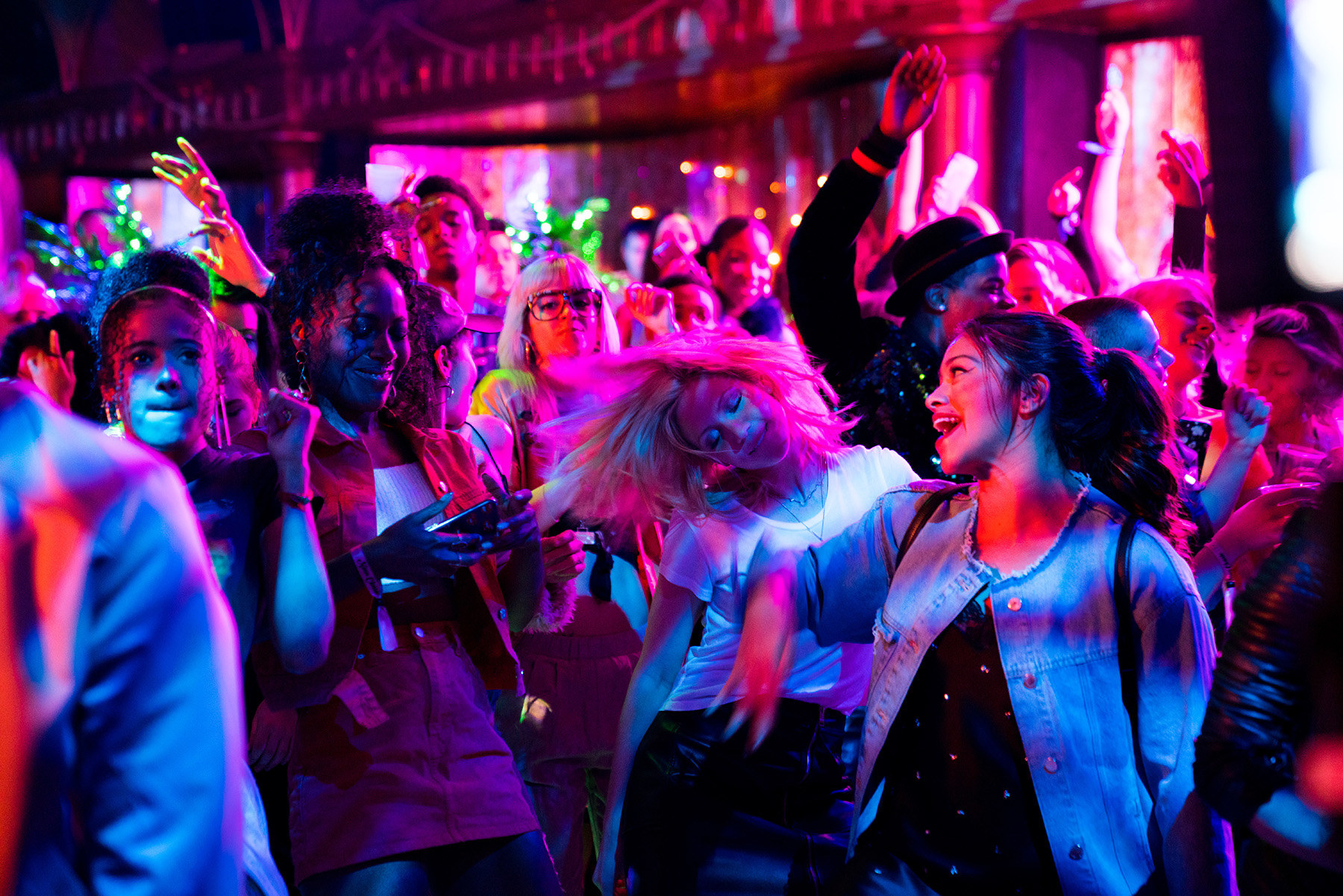 still image from the movie someone great, in the still is gina rodriguez, brittany snow and dewanda wise dancing at a club