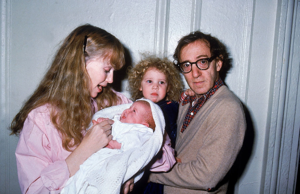 Mia Farrow holding baby Ronan while Woody is holding baby Dylan