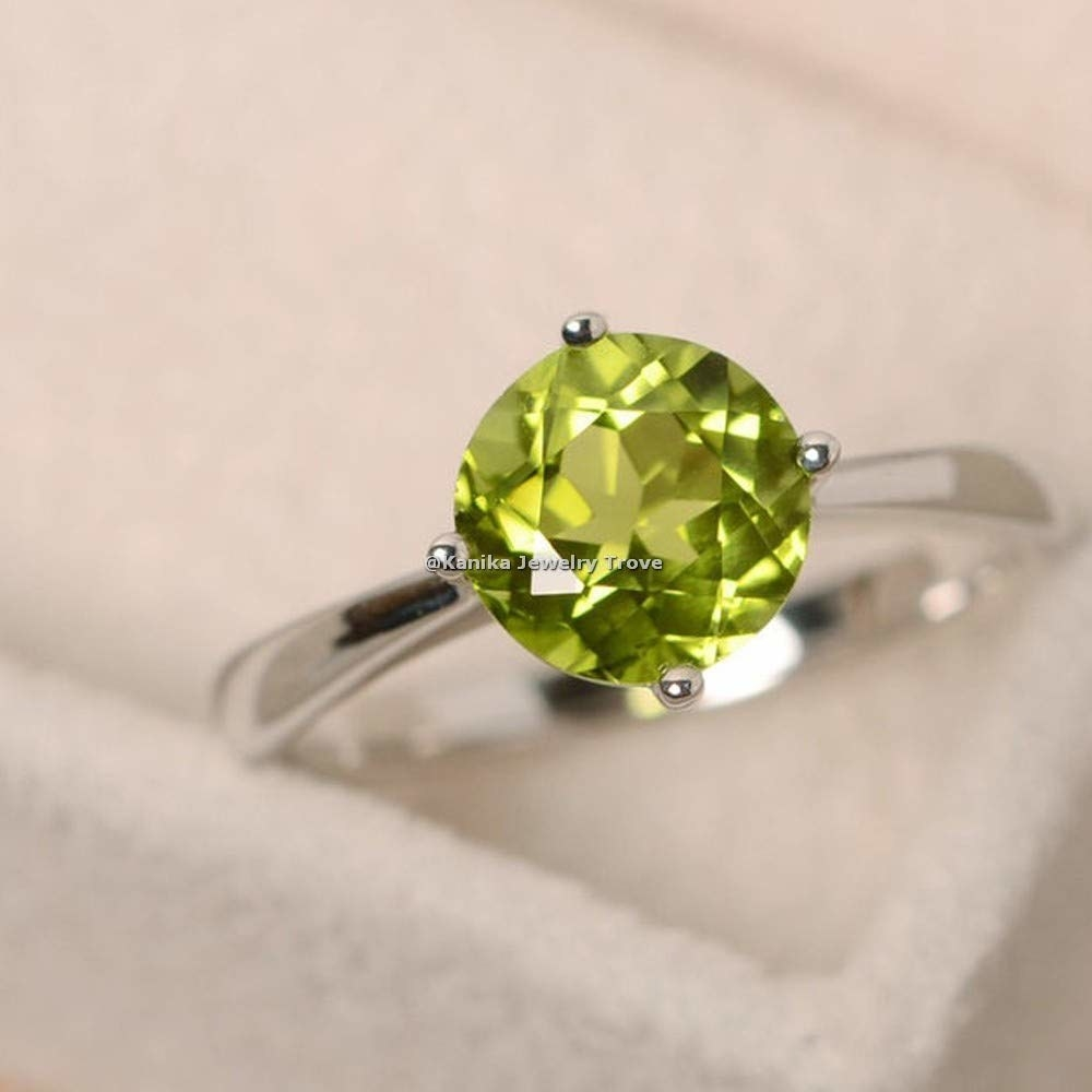 green round stone with silver band