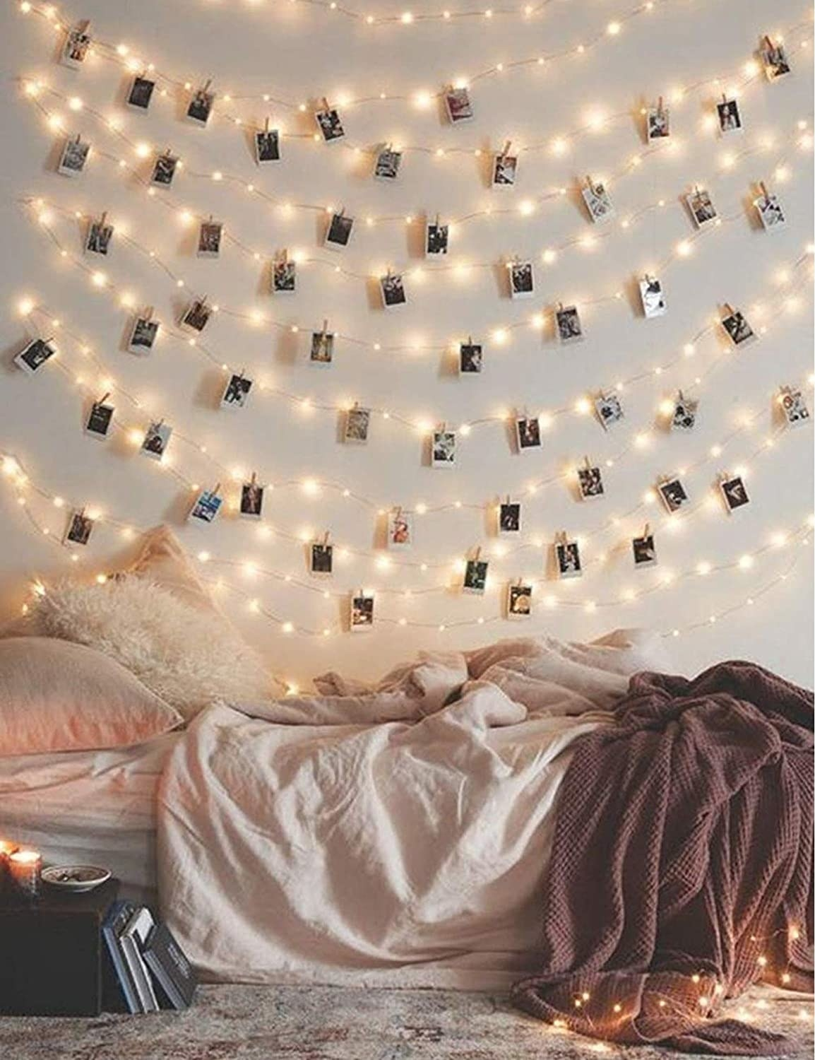 rows of Photo Clip String Lights hang above a bed
