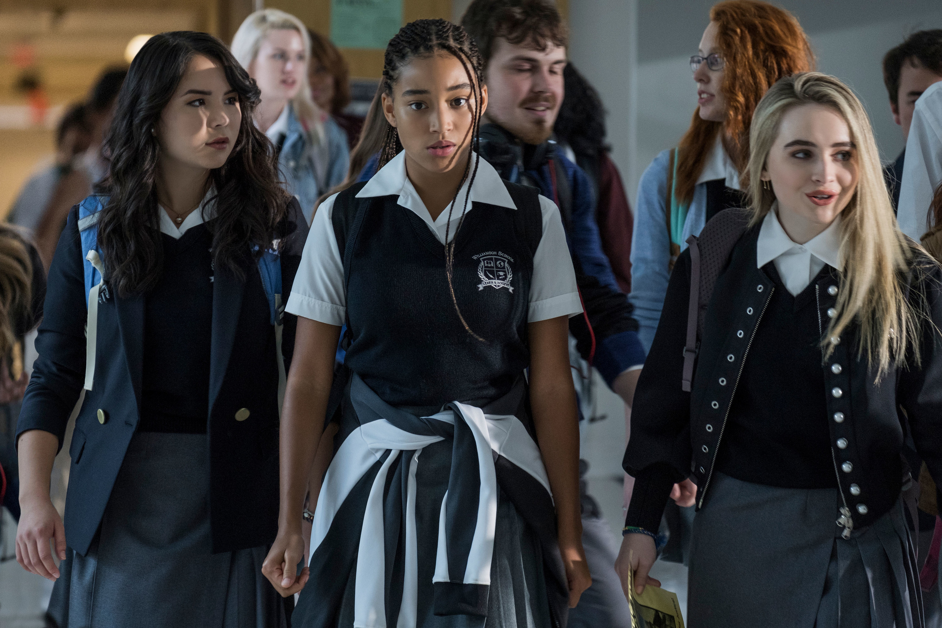 still image from the movie the hate you give in the still is megan lawless, amandla stenberg and sabrina carpenter walking in school