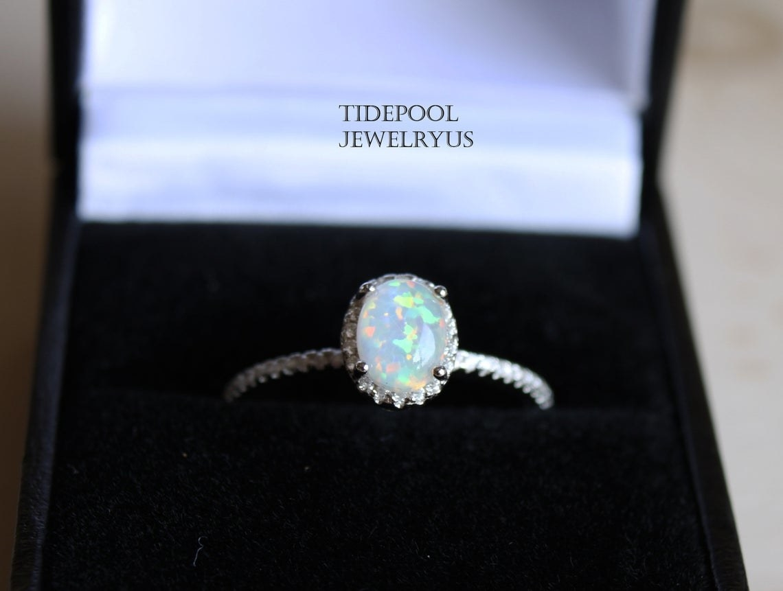 oval opal in roped band