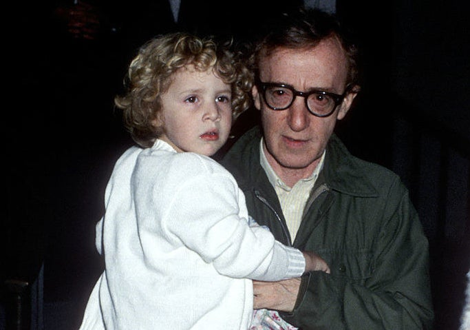Woody Allen carrying a baby Dylan