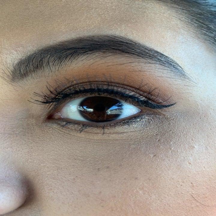 Reviewer photo showing their false eyelash perfectly applied using the eyelash adhesive