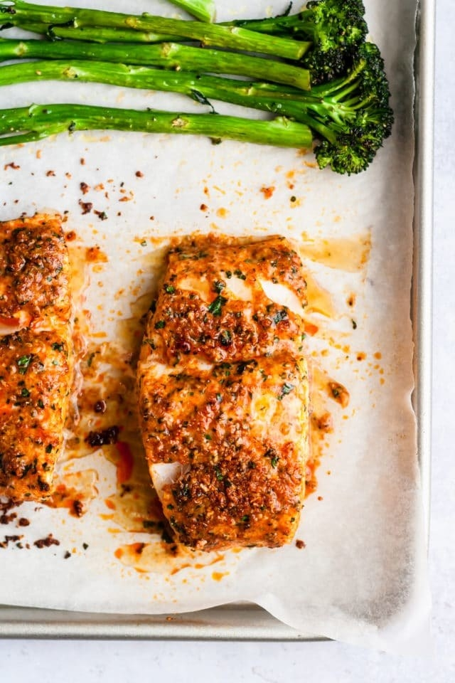 Parmesan crusted cod and broccolini on a sheet pan.