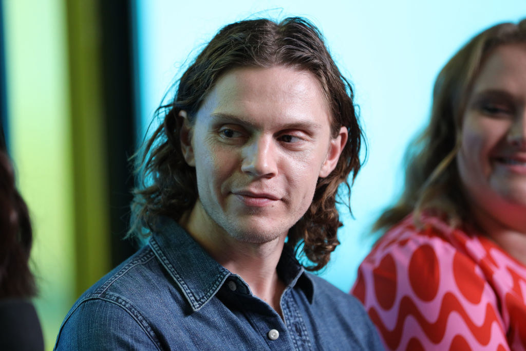 Evan Peters talking on a panel in 2019