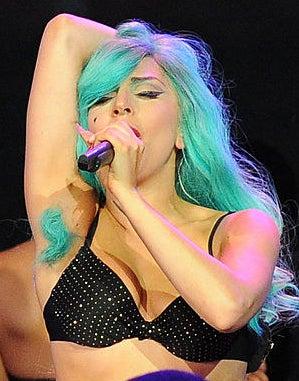 A singer proudly displaying dyed armpit hair