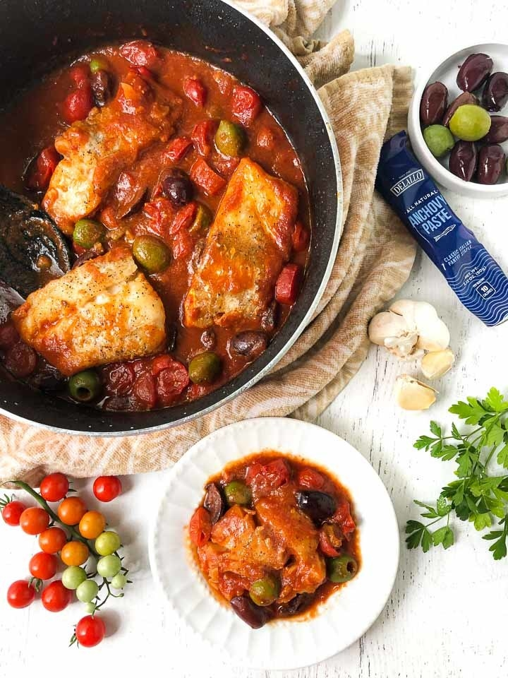 Mediterranean cod in tomato sauce with olives.