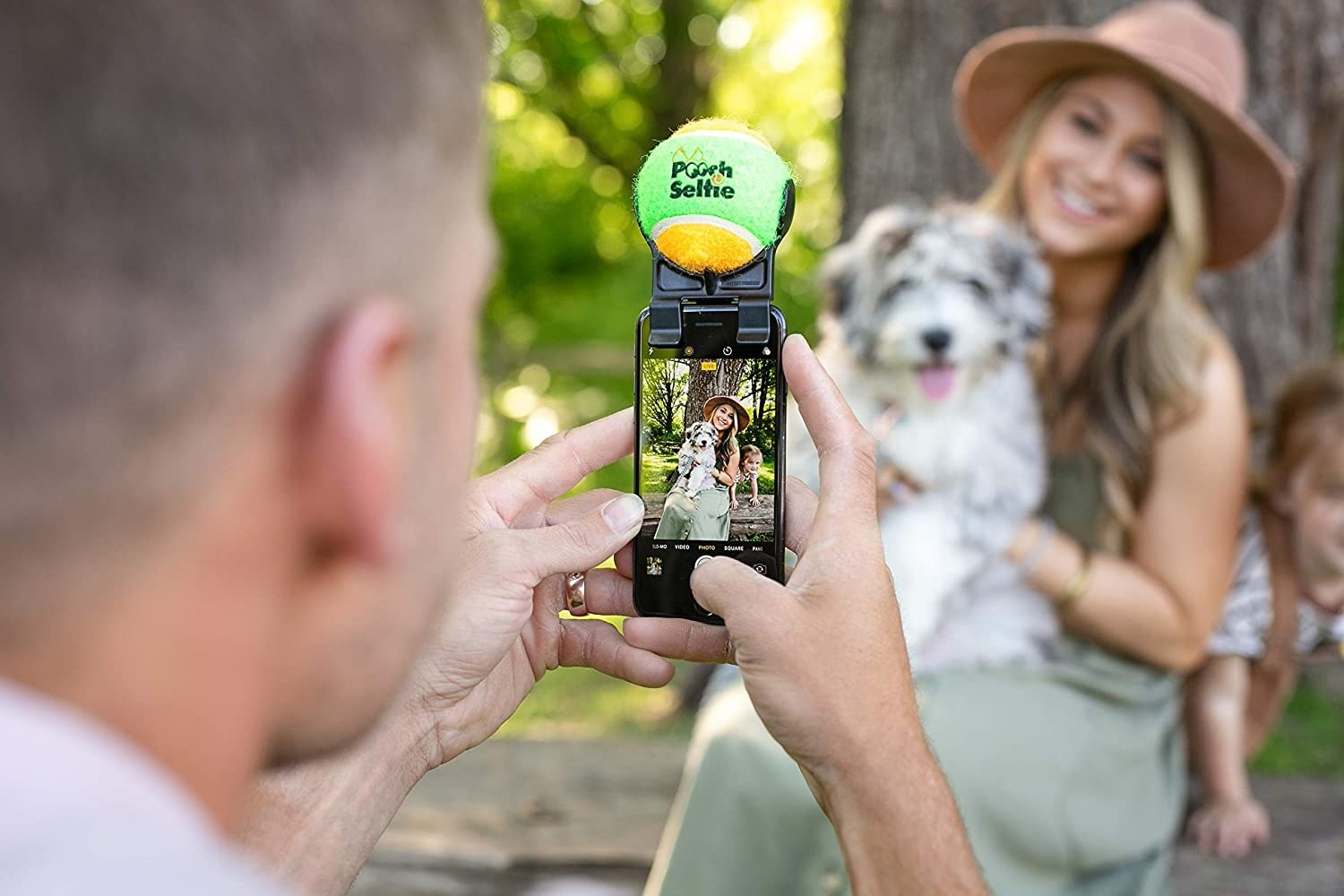 a model posing with a dog for a photo taken with the pooch selfie