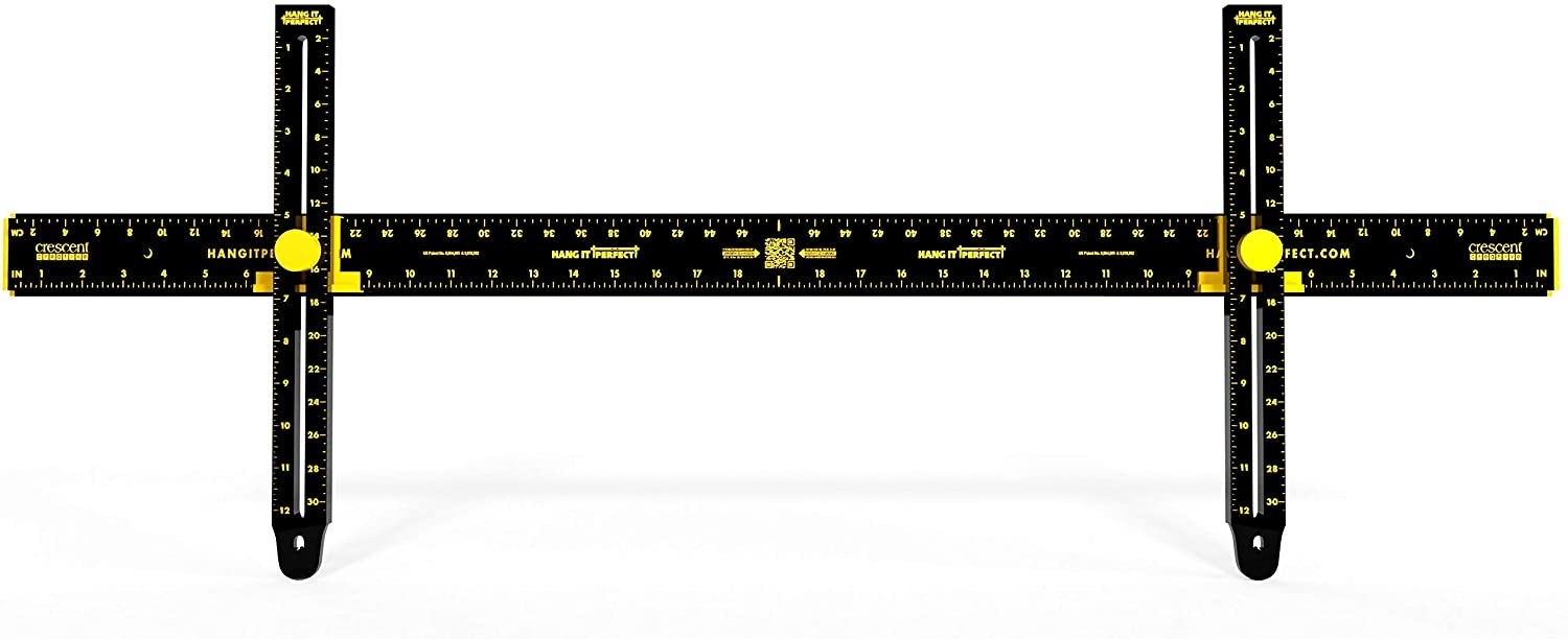 the tool, which looks like a long ruler with two adjustable vertical parts