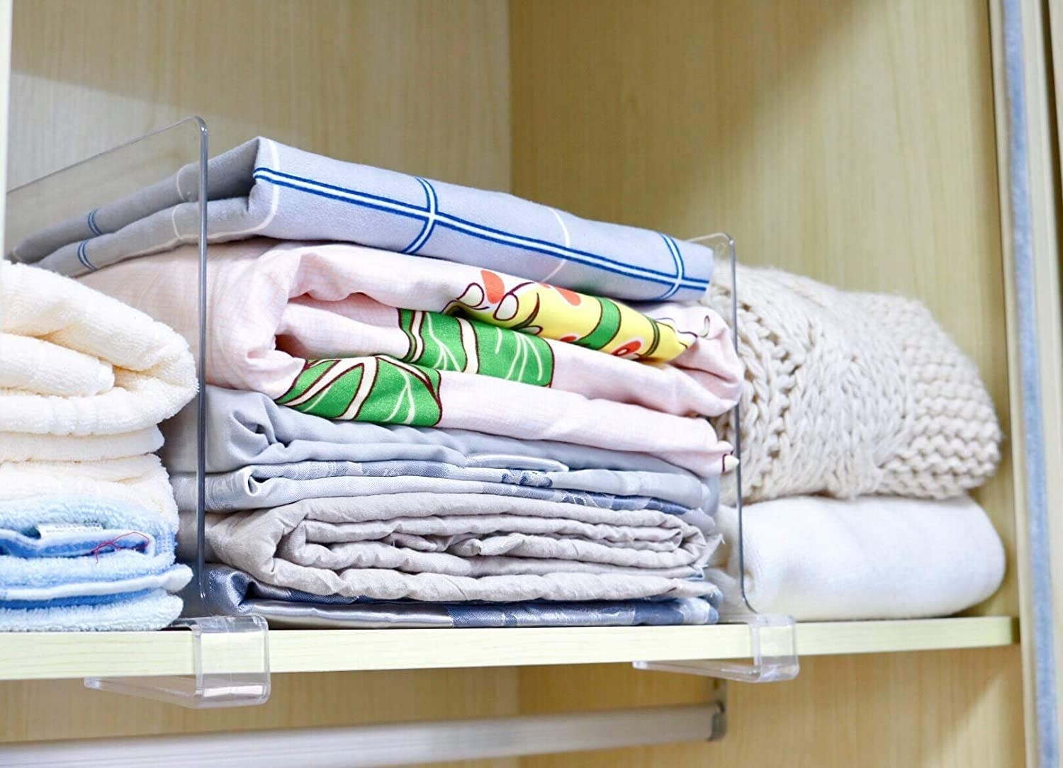 stacks of clothes between the dividers