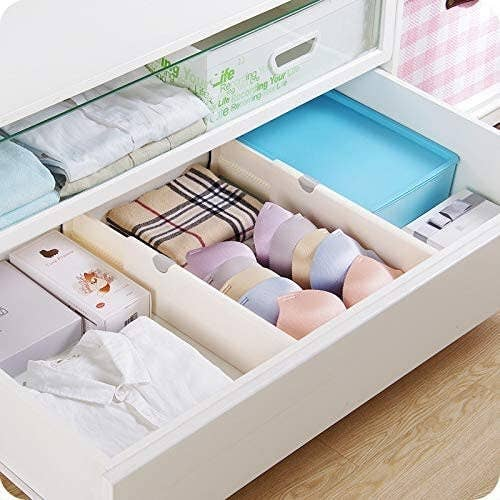 the dividers in a drawer separating clothes