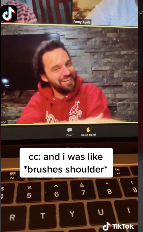 Jake brushing his shoulder