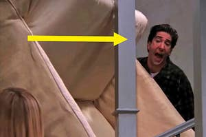 Ross from friends carrying his couch up the stairs