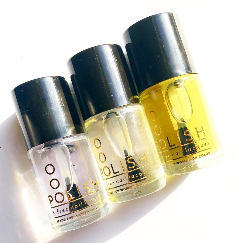 bottles of a clear top coat, base coat, and cuticle oil