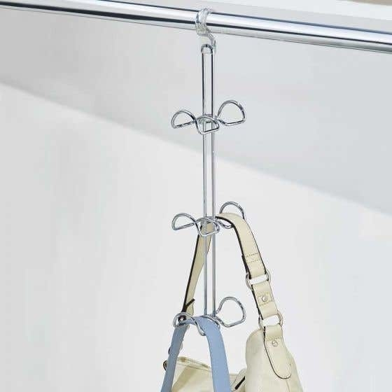 the hanger with two purses on it