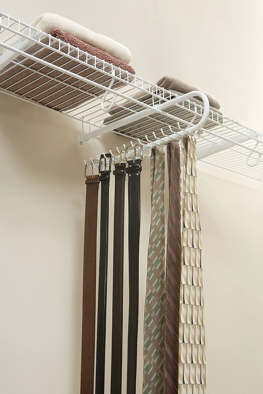 ties and belts hanging from the organizer that's hooked onto a wire shelf
