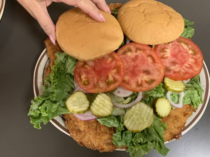 A huge pork tenderloin sandwich in Iowa on a platter