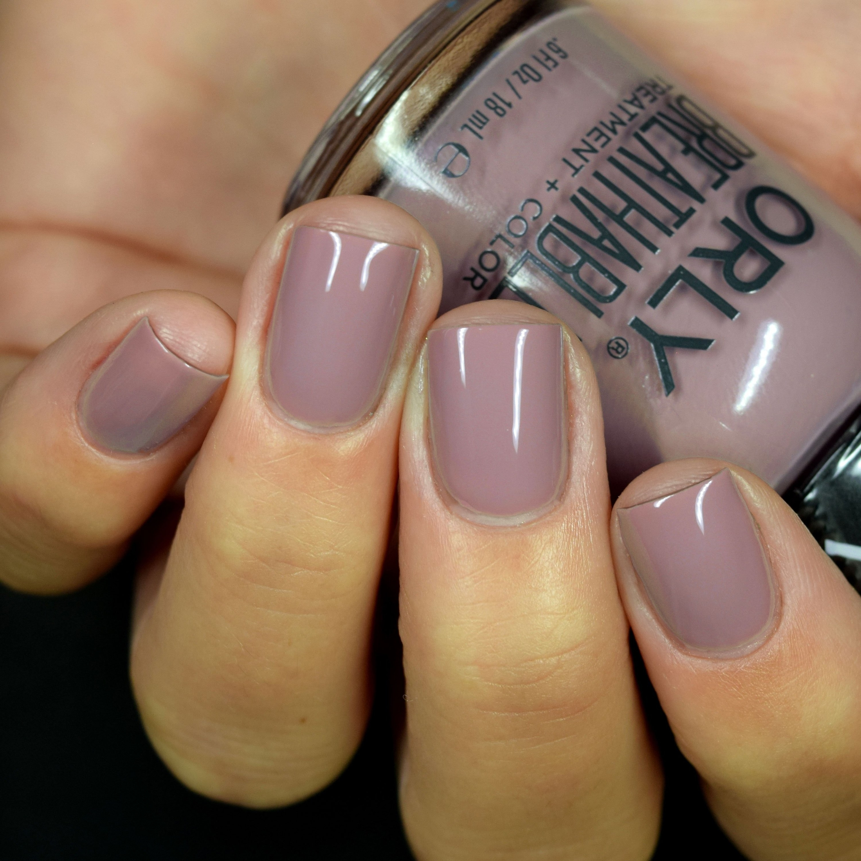 model wears light purple Orly breathable one-step polish on fingers