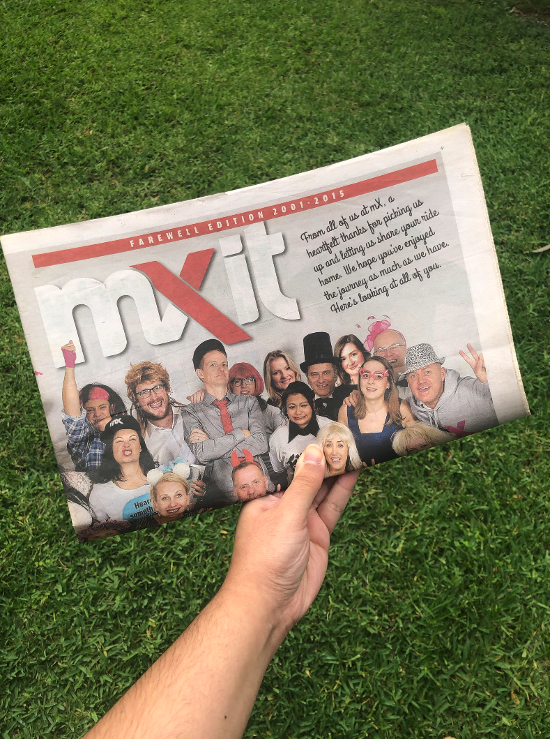 A hand holding mX's final edition