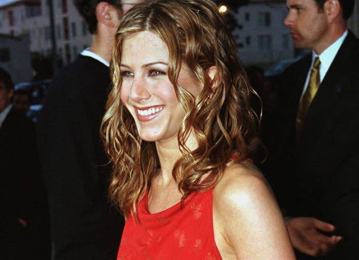 Jennifer poses on a red carpet in 1998