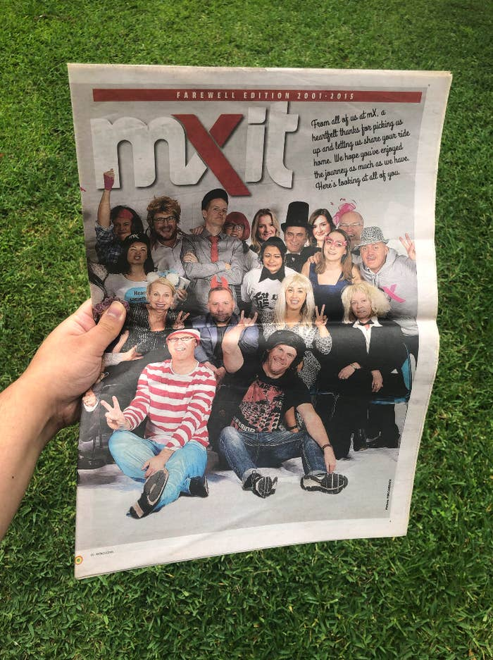 A hand holding an edition of mX
