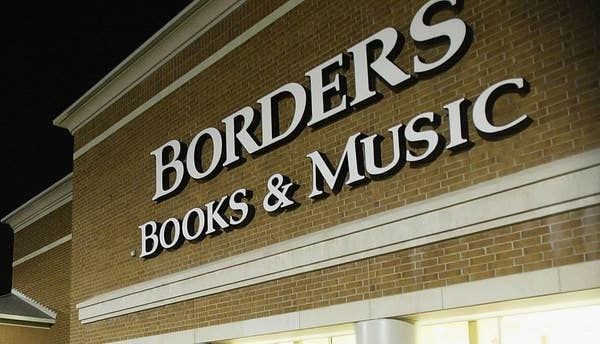 Exterior sign for Borders Books & Music at night