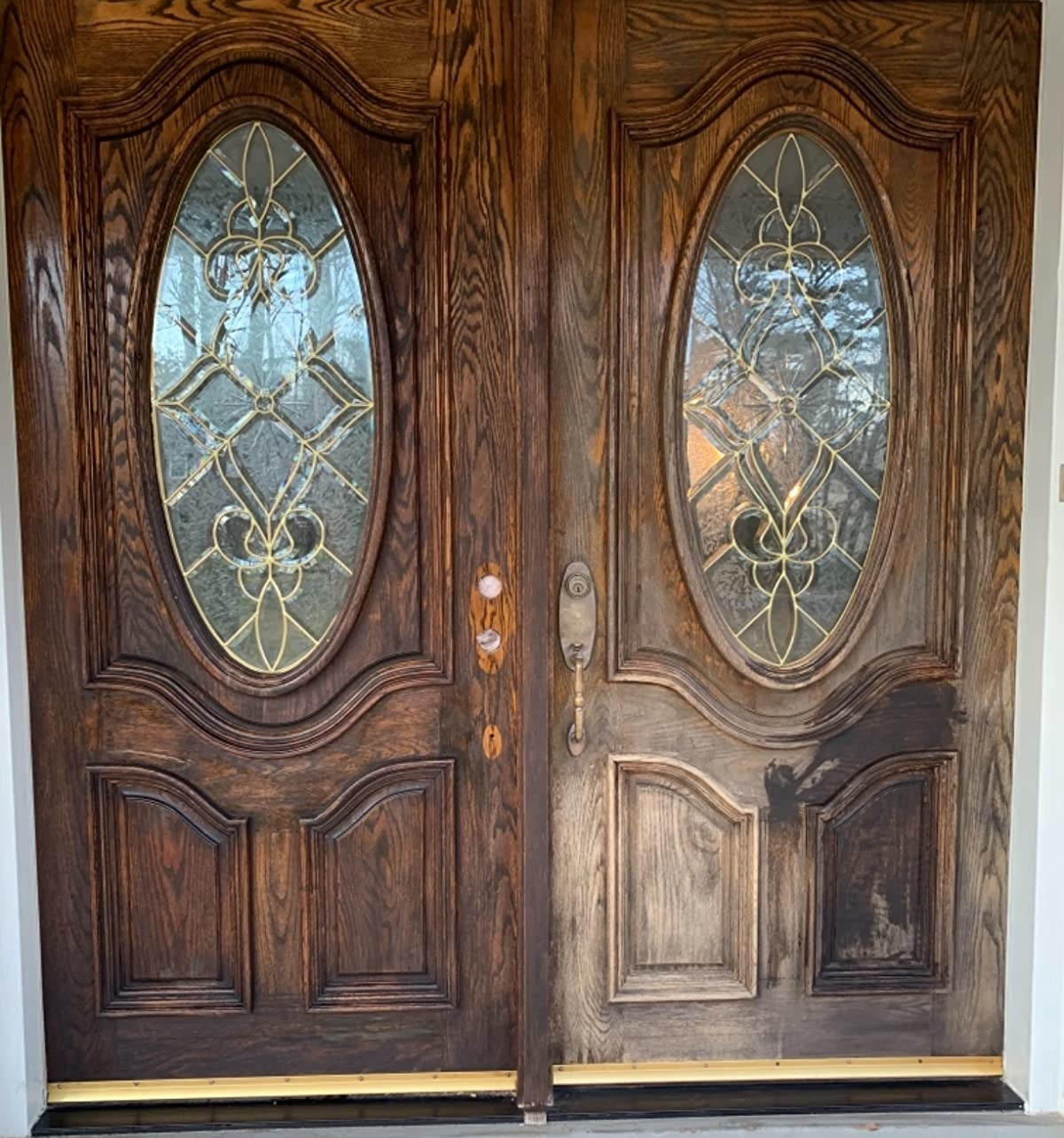 reviewer photo showing a dramatic before and after of their front doors