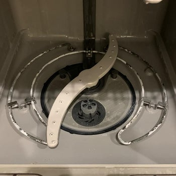 same reviewer showing their dishwasher looking brand new after using the cleaning tablets