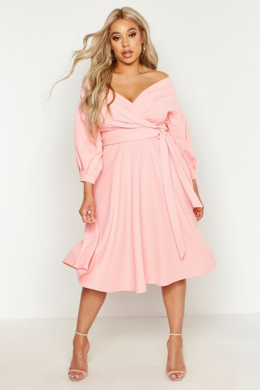 A model wearing the midi dress in pink