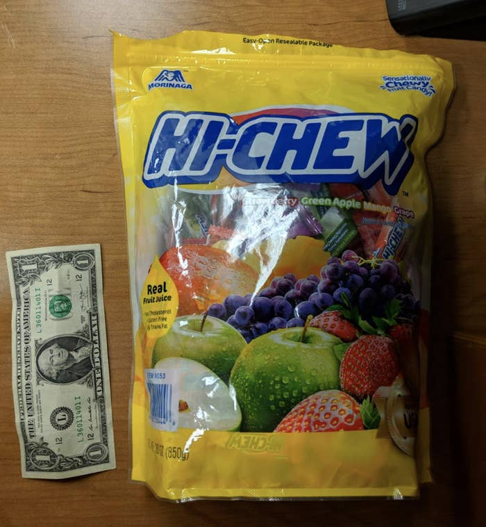 reviewer photo of Hi-Chew bag placed next to a dollar bill to show how large the bag is