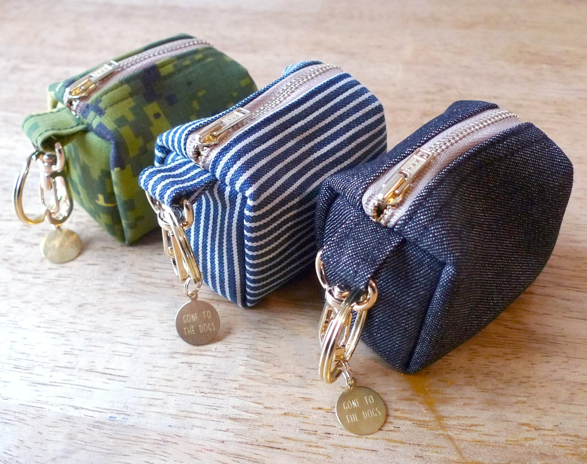 the poop bags in green, blue and white stripes, and denim