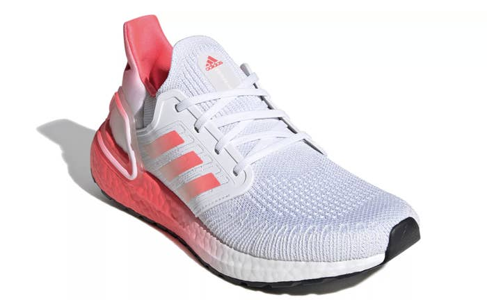 adidas pink and white running sneaker with a knitted front and pink stripes on the side