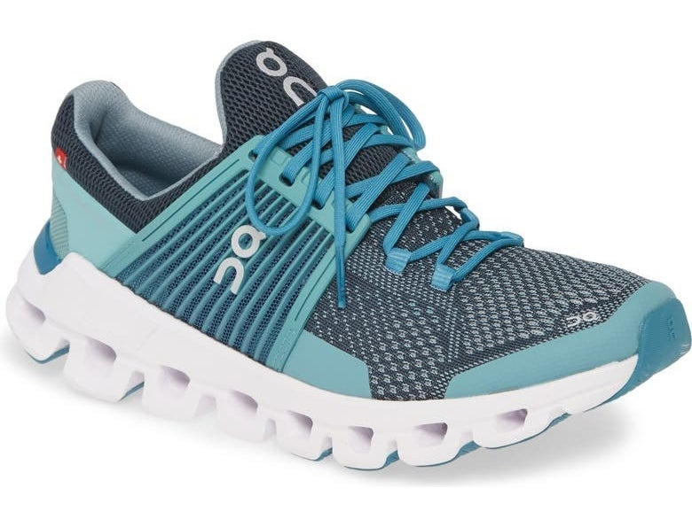 teal running sneaker with gray upper, blue laces, and a sock-like heel compartment