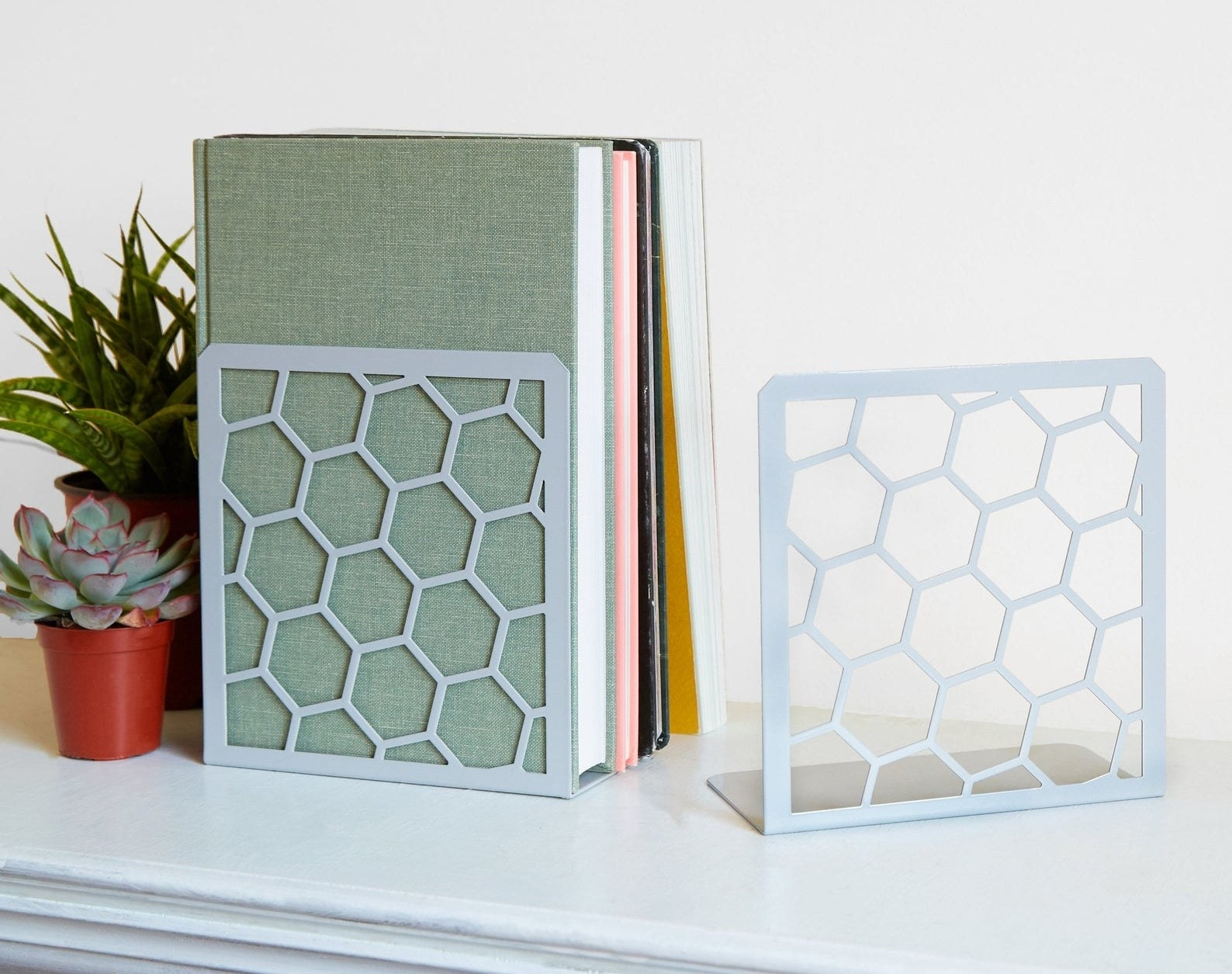 honeycomb book ends in pale blue