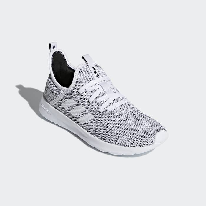 A single running shoes with three white stripes on the side